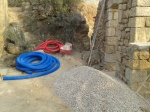 drain making material, the blue pipe, gravel, plus a huge plastic sheeting