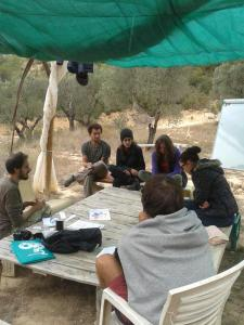 Alessandro leading an Introduction to Permaculture session on Day 1 (see the permaculture flower there on the table?)